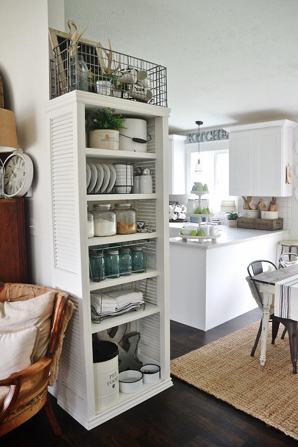 Picture Of diy kitchen bookshelf with shutter doors  1