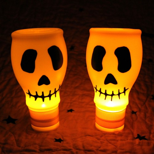 These awesome skulls are made of milk bottles and black electrical tape.  That's a great craft project for kids! (via dollarstorecrafts)