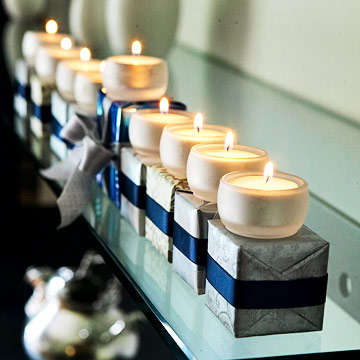 Tea Lights And Wrapped Boxes DIY Menorah (via bhg)