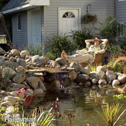 backyard pond with a waterfall (via familyhandyman)