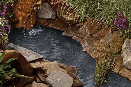 rock backyard pond (via thisoldhouse)