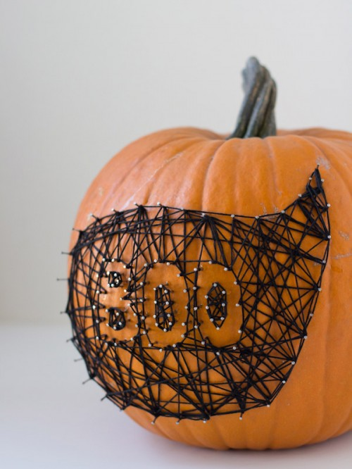 string nail art pumpkin