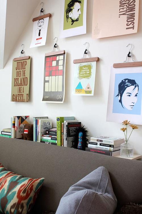 cloth hangers photo display (via shelterness)