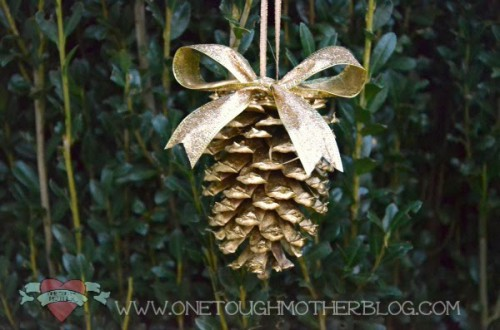 gold pinecone ornaments (via sweetteaandsavinggraceblog)