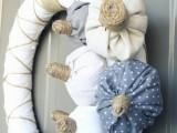 fabric pumpkins on white wreath