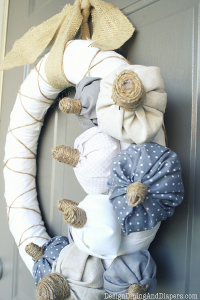 fabric pumpkins on white wreath (via designdininganddiapers)