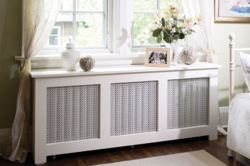 A radiator cover hides a big, utilitarian device in a more aesthetically pleasing package and the flat top gives you a little extra storage or display space. Off-the-rack lumber and easy joinery would suffice for such project. (via canadianhomeworkshop)