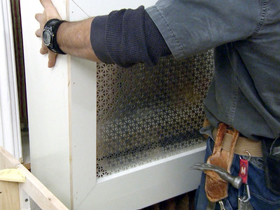 The most difficult part in this project is to determine the interior dimension of your cover, allowing clearance for heat all the way around the unit. Mistakes aren't allowed on this step. (via diynetwork)