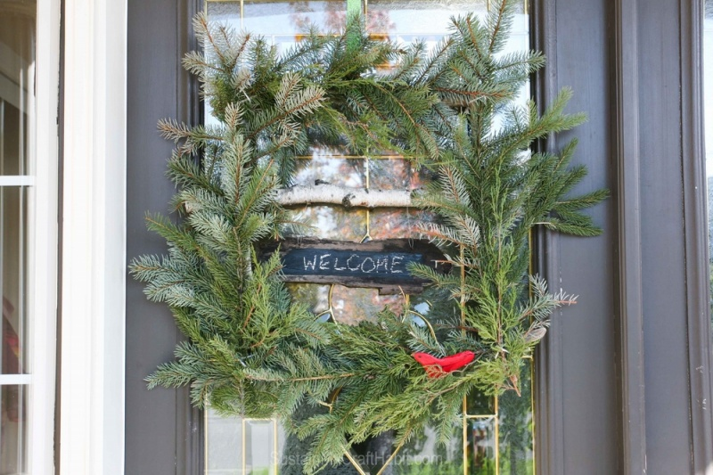 Picture Of diy ruby bird on a window holiday wreath  1