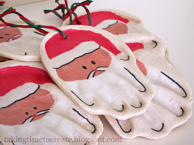 handprint Santa ornaments of salt dough (via takingtimetocreate)