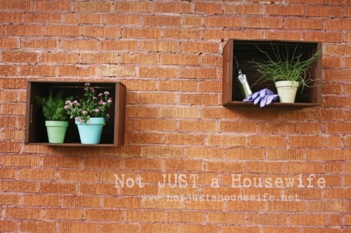 DIY Shadow Boxes For A Brick Wall Of Crates