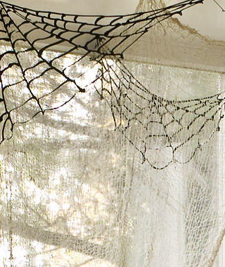 DIY Spiderwebs To Decorate Your Ceilings Corners For Halloween