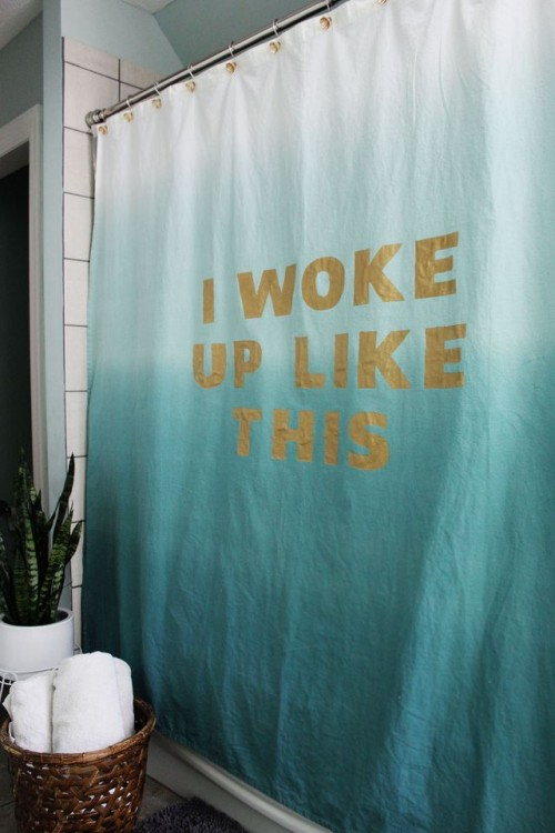 statement shower curtain (via abeautifulmess)