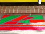 welcome mat with spray paints