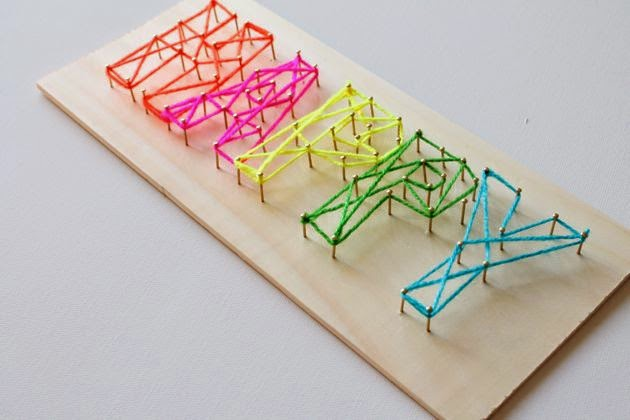 colorful HAPPY string nail art