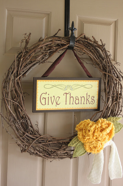 Thanksgiving wreath and sign (via embellishgoods)
