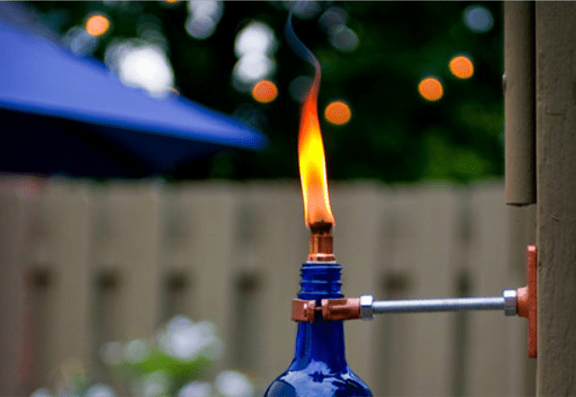 blue wine bottle tiki torch
