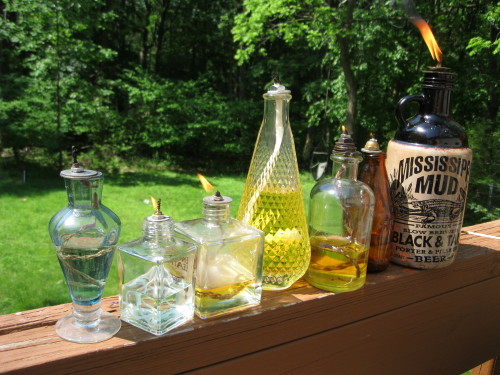 old glass bottles torches