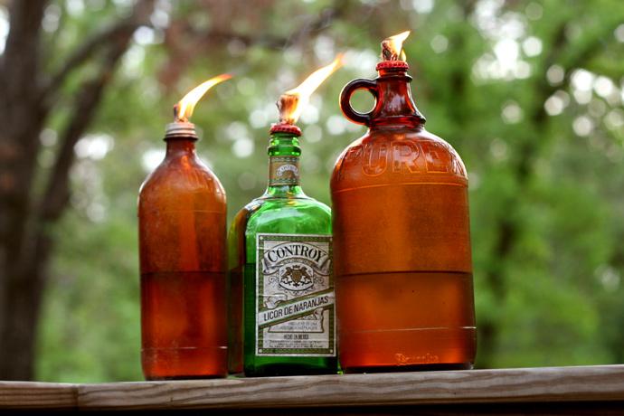 vintage bottle tiki torches