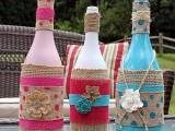 decorated tiki wine bottles