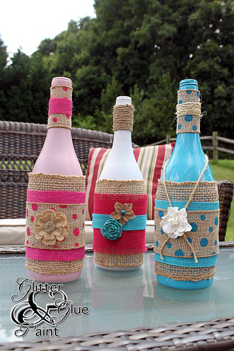 decorated tiki wine bottles