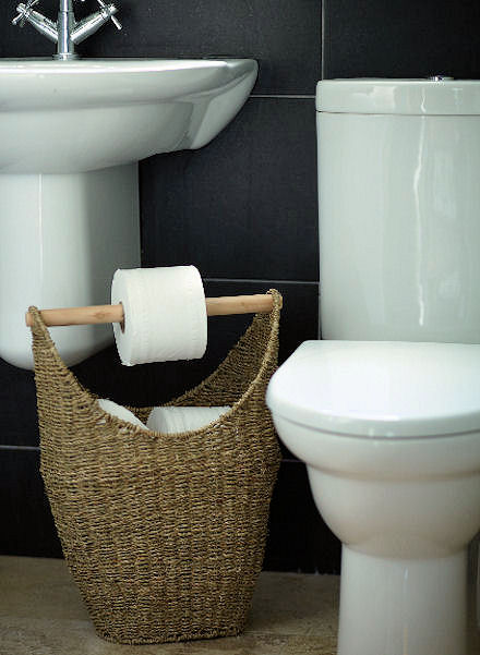 5 diy toilet paper storage solutions shelterness for Diy toilet paper storage
