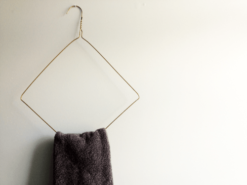 wire towel hanger (via adailysomething)