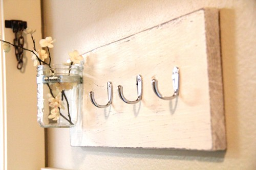 bathroom towel hooks (via shelterness)