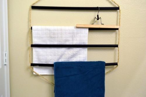 plastic tubes towel rack (via sparkandchemistry)