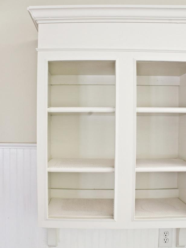 distressed whitewashed kitchen cabinets