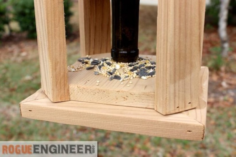 Picture Of diy wine bottle and wood bird feeder  3