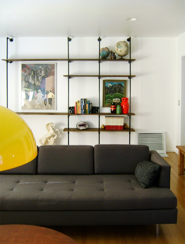 diy wood shelving units connected with pipes diy living room