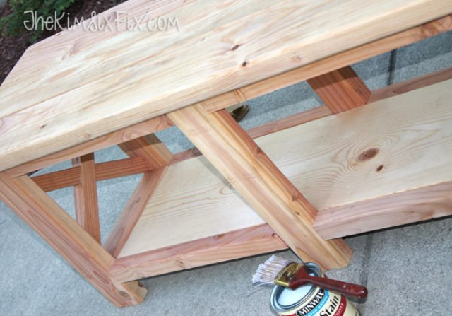 Picture Of diy x leg wooden banch with crate storage  6
