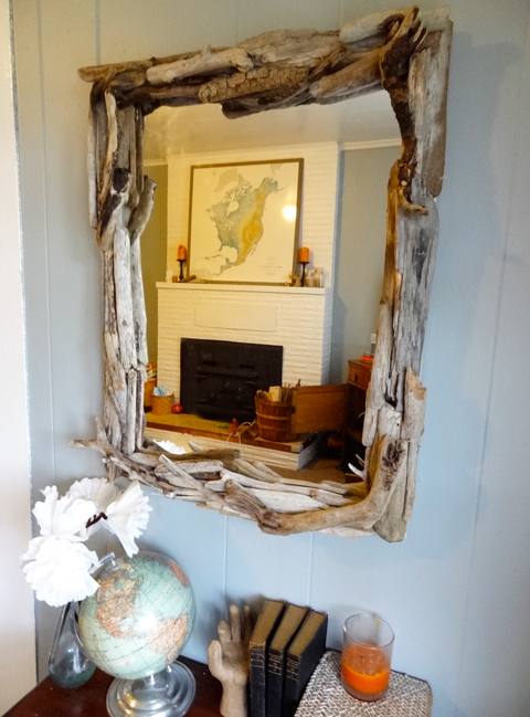 big driftwood mirror (via revamphomegoods)