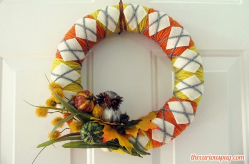 yarn wreath with faux veggies (via shelterness)