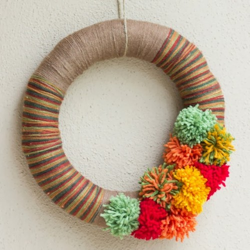yarn and pompom wreath (via designimprovised)