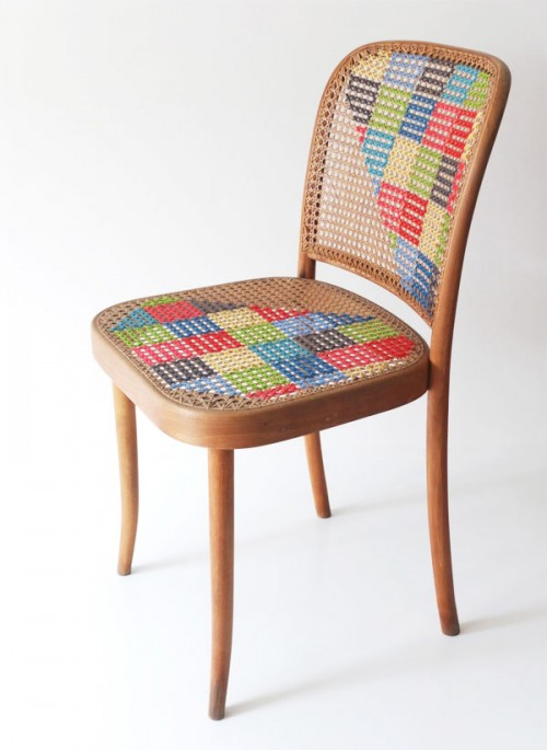 cross stitching an old chair