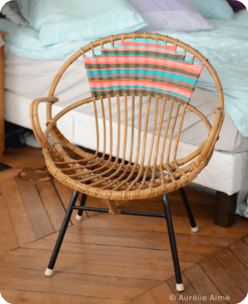 decorating a rattan chair with yarn