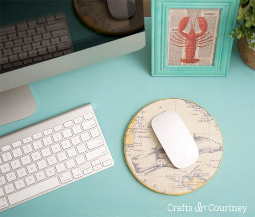 scrapbook paper and cork mouse pad (via shelterness)