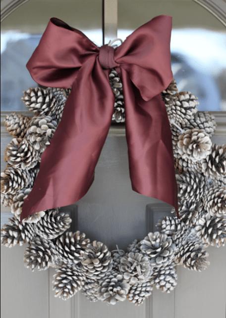 pinecone wreath with a ribbon bow (via doityourselfdivas)
