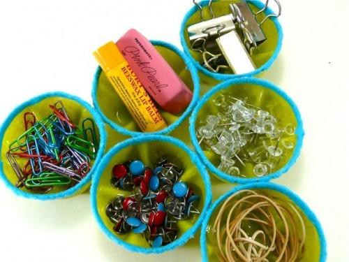 soda bottles desk organizer (via makezine)