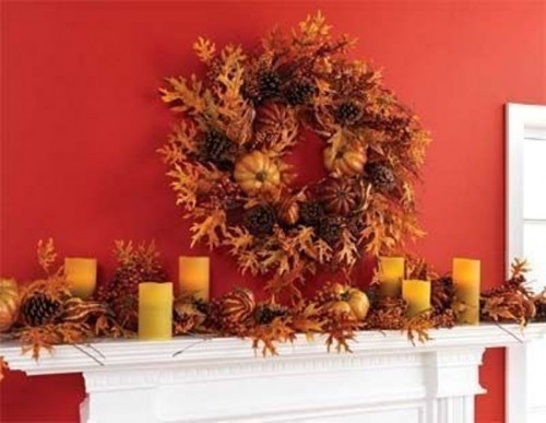 Mix faux leaves, candles and pinecones for an impressive late fall mantel.