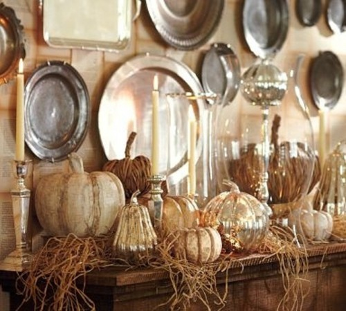 Spice up your mantel with metallic pumpkins. Spray painted, they definitely would add some drama to any arrangement.