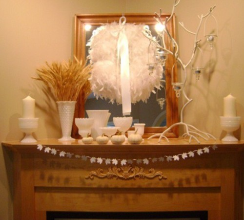 Hanging a wreath on a mirror is a quite interesting solution for fall mantel decor. Adding some wheat steams in the vase is also a great idea to spice things up for the season.