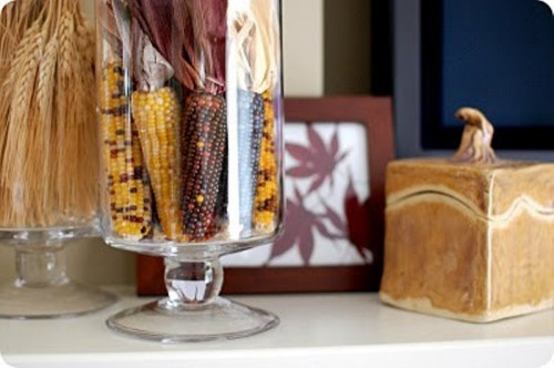 Do you have a bunch of cool vases? Stuff them with indian corn and wheat for a simple and quick mantel decor. For a more personal touch, add a DIY faux pumpkin.