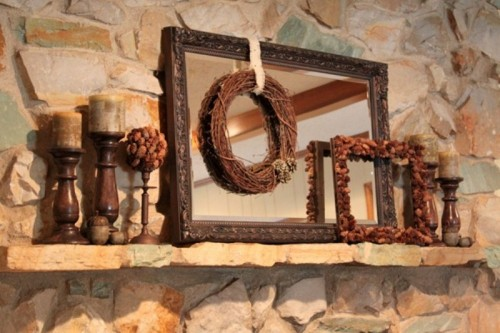 Layering things up is a great way to make a bigger impact with your decor. A mirror becomes a perfect backdrop for a wreath and other seasonal decor items.