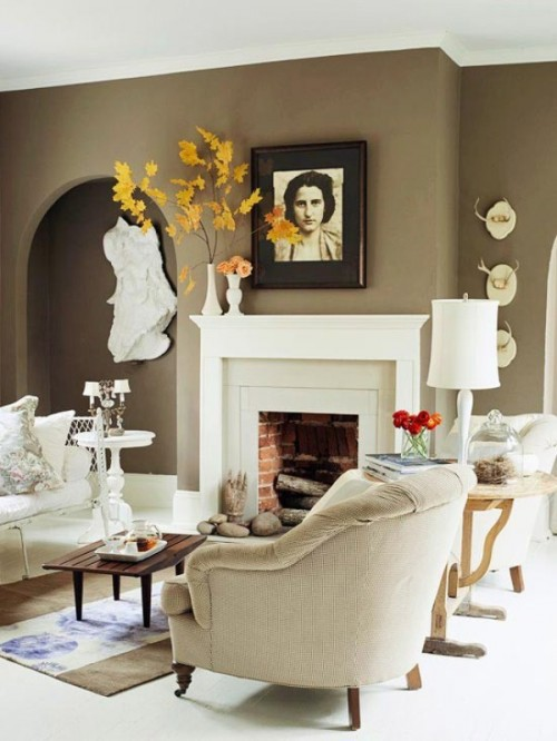 A tree made of backyard sticks with dried leaves adds some height and dimension to any fall mantel.