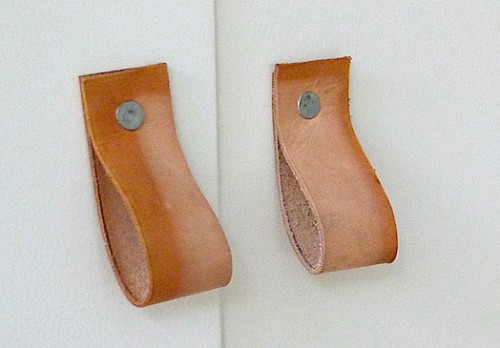 leather cabinet pulls (via shelterness)