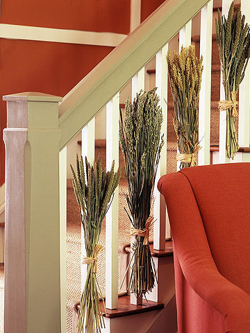dried wheat bundles attached to the railing are cool for the fall, you may also accent other spaces with wheat too