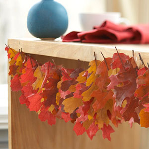 a garland of colorful dried fall leaves is a nice and bright decoration you can easily make